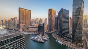 Amazing colorful dubai marina skyline during sunset timelapse. Great perspective of multiple tallest skyscrapers of the world with yachts and boats on canal stock video