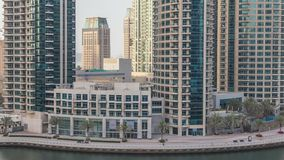 Amazing colorful dubai marina skyline during sunset timelapse. Great perspective of multiple tallest skyscrapers of the world with yachts and boats. Sunlight stock video