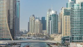 Amazing colorful dubai marina skyline during sunset timelapse. Great perspective of multiple tallest skyscrapers and bridge with yachts and boats. Sunlight stock footage