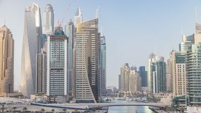 Amazing colorful dubai marina skyline during sunset timelapse. Great perspective of multiple tallest skyscrapers of the world with yachts and boats. Sunlight stock footage