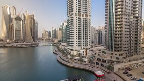 Amazing colorful dubai marina skyline during sunset timelapse. Great perspective of multiple tallest skyscrapers of the world with yachts and boats. Sunlight stock video footage