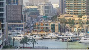 Amazing colorful dubai marina skyline during sunset timelapse. Great perspective of skyscrapers with yachts and boats. Traffic on the bridge. Sunlight over stock video footage
