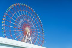 Amazing colorful ferris wheel in amusement park with sunshine blue sky in the morning with copy space, can be used as optimistic. Or start new day with stock photo