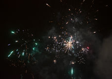 Amazing colorful fireworks on a night sky background Royalty Free Stock Images