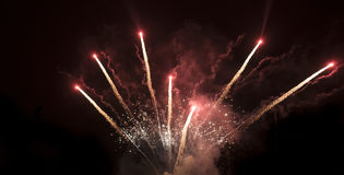 Amazing colorful fireworks on a night sky background Royalty Free Stock Photos
