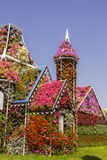 Amazing colorful house of flowers in the Miracle Garden. Background landscape amazing house made of flowers with a small tower in the garden of Miracle Garden Royalty Free Stock Photography
