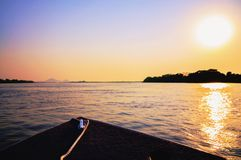 Amazing colorful landscape at sunset of a boat navigating on Pan. Tanal waters. The front of the boat surrounded by water and nature. Photo at golden hour in royalty free stock photo
