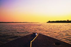 Amazing colorful landscape at sunset of a boat navigating on Pan royalty free stock image
