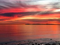 Colorful sunset Newport Beach California. Amazing colorful reflective Pacific Ocean sunset at Crystal Cove Newport Beach California royalty free stock images