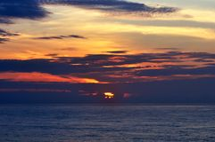 Amazing beautiful Sunrise at sea Scenery, seascape. Amazing colorful sunrise at sea scenery.Dramatic landscape.The black clouds are burning by the sun stock images