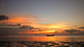 Amazing Colors of Tropical Sunset. Fisherman Thai Wooden Sail Boat Silhouette Floating on Sea Horizon. HD Slowmotion stock video footage