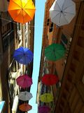 An amazing coloured umbrellas decoration over the city of Genova. In spring days for the Euroflora event stock images