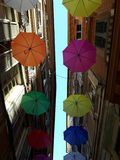 An amazing coloured umbrellas decoration over the city of Genova. In spring days for the Euroflora event stock photography