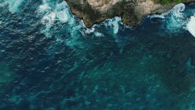 Amazing colourful nature scene of beautiful azure water, rocky cliffs with trees. Magnifficent top down view on tropical