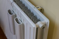 Amazing composition of indoor wall heater, warmer or radiator. With two white water reservoir, tank or holders on it. Attatched to stock photos