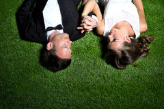 Amazing couple lying on the grass Royalty Free Stock Photography