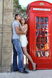 Amazing couple portrait near red telephone box Stock Photography