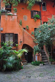 Amazing courtyard in Rome. Pictoresque courtyard in the center of Rome with orange painted wall Royalty Free Stock Photos