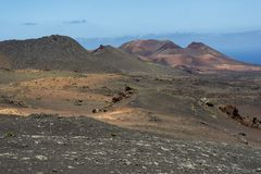 Amazing crater in a volcanic landscape of Timanfaya national park, Lanzarote, Canary Islands royalty free stock photos