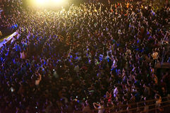 Amazing crowded young people in earth hour event. HO CHI MINH CITY, VIET NAM- MAR 29: Outdoor stage at night to respond earth hour campaign, worldwide event stock image