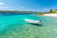 Blue adriatic sea with boat on Peljesac peninsula in Dalmatia, Croatia. Amazing crystal clear water in south dalmatia, Croatia stock photography