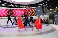 An amazing dance performance in the booth of Cadillac Stock Image