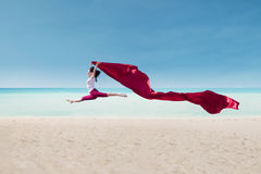 Amazing dance with red flag at beach royalty free stock image