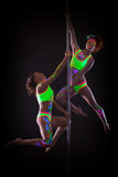 Amazing dancers posing with luminous neon makeup. On gray background Stock Image