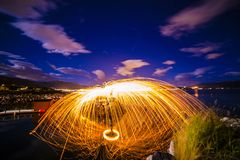 Tromso light painting sparks spinning Norway Stock Photo