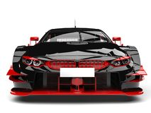 Amazing dark race car with red details - front view closeup shot Royalty Free Stock Photos