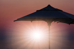 Amazing dawn with parasol at background Royalty Free Stock Photos
