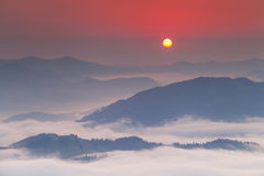 Amazing dawn sky over the  mountains Stock Photography