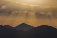 Amazing dawn sky over the  mountains Stock Photo