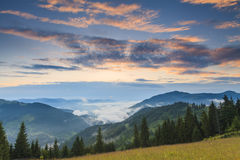 Amazing dawn sky over the mountains Stock Photos