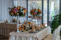 Amazing decoration of table. Beautiful restaurant interior table decoration for wedding. Flower Wedding Table Decoration royalty free stock images
