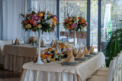 Amazing decoration of table. Beautiful restaurant interior table decoration for wedding. Flower Wedding Table Decoration stock images