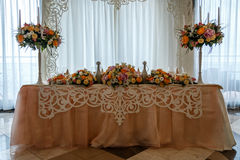 Amazing decoration of table. Beautiful restaurant interior table decoration for wedding. Flower Wedding Table Decoration royalty free stock photo