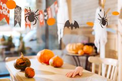 Amazing decorations as painted pumpkins and sweets in the form of scary fingers. Amazing decorations. Amazing decorations as painted pumpkins and sweets in the stock photo