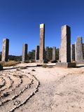 Amazing design - 13 basalt pillars, one of which is covered with gold. Stonehenge in Ibiza. royalty free stock photography
