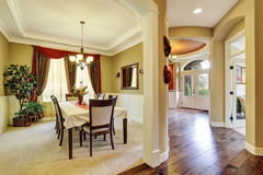 Amazing dining room interior with nice curtains. Royalty Free Stock Photography