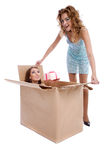 Amazing discover. One girl finding another girl in box Royalty Free Stock Image