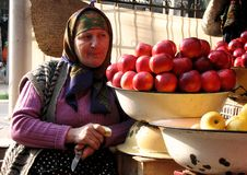 Amazing Display of Apples and an Old Woman Stock Photo