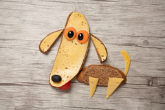 Amazing dog made of bread and cheese on board Royalty Free Stock Photo