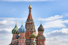 Amazing Domes of St. Basil`s Cathedral Over the Clouds - St. Basi Royalty Free Stock Images