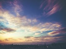 An amazing dramatic cloudy sunset over the city and a beautiful dramatic sky with clouds.  stock images