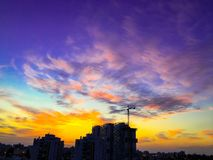 An amazing dramatic cloudy sunset over the city and a beautiful dramatic sky with clouds.  stock photography