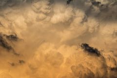 Amazing dramatic nature background from storm clouds. In evening light royalty free stock image