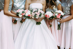 Amazing dresses of the bridesmaids and a bride. A Stock Photo