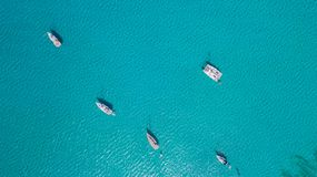 Amazing drone aerial landscape of the charming area of Es Trencs and the boats with a turquoise sea stock images