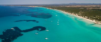 Amazing drone aerial landscape of the charming beach Es Trencs. It has earned the reputation of Caribbean beach of Mallorca. Spain stock images